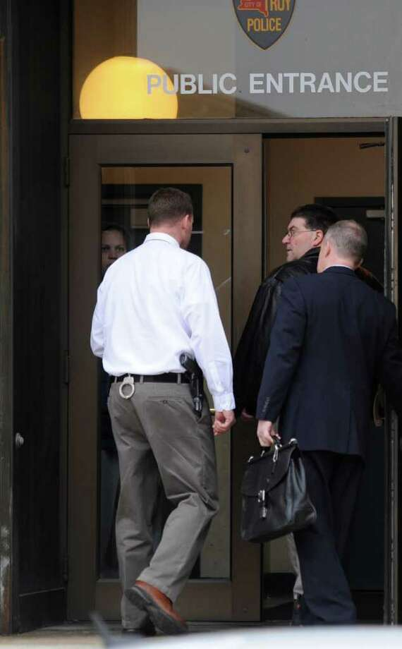 Thomas McMartin, center, enters the Troy, N.Y. police station with his lawyer on March, 16, 2012.      (Skip Dickstein / Times Union) Photo: SKIP DICKSTEIN / 2011