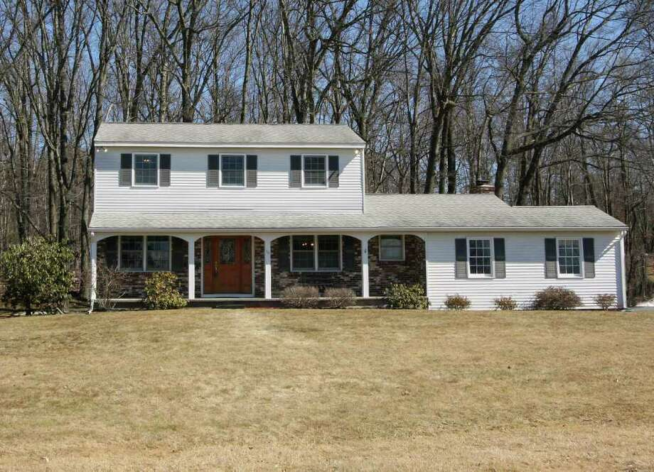 This three-bedroom, 1,738-square-foot center hall Colonial with 1.5 bathrooms and an attached one-car garage at 16 Boncroft Drive is selling for $224,900. (Michael Lisi photo)
