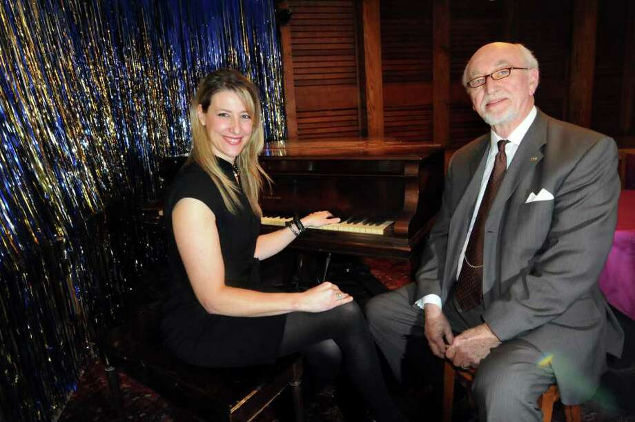 Kate Kaufman Burns, Board president, left, and Robert Harrison, chairman of Fundraising and Development, at the piano in a bar off the main theater on Tuesday, Feb. 28, 2012, at Schenectady Light Opera Company in Schenectady, N.Y. (Cindy Schultz / Times Union) Photo: Cindy Schultz / 00016565A