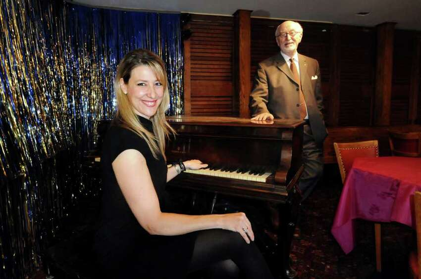 Kate Kaufman Burns, Board president, left, and Robert Harrison, chairman of Fundraising and Development, at the piano in a bar off the main theater on Tuesday, Feb. 28, 2012, at Schenectady Light Opera Company in Schenectady, N.Y. (Cindy Schultz / Times Union)