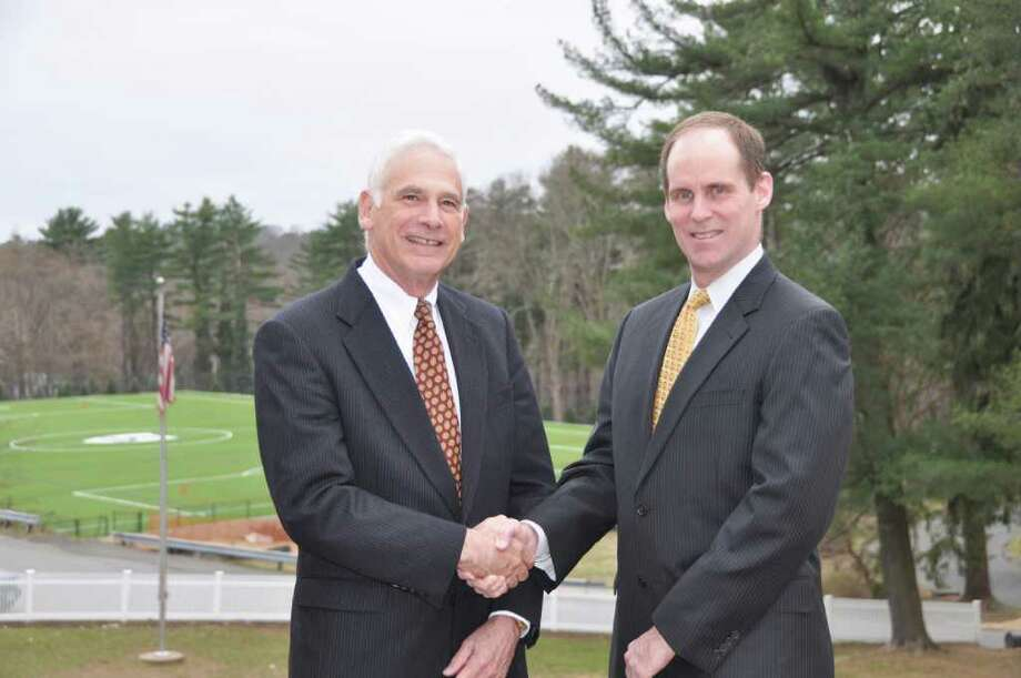Bill Grad, left, chairman of the Greenwich Reform Synagogue's Board of Trustees, and Greg Drennen, chairman of The Stanwich School's Board of Trustees, shake hands in this undated photo. Stanwich School and Greenwich Reform Synagogue have reached a deal in which the school will buy the synagogue's 11.5-acre site at 257 Stanwich Road. Photo: Contributed Photo / Greenwich Time Contributed