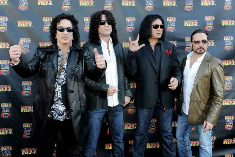 Kiss singer/guitarist Paul Stanley, guitarist Tommy Thayer, singer/bassist Gene Simmons and drummer Eric Singer arrive at the grand opening of the KISS by Monster Mini Golf amusement attraction on March 15, 2012 in Las Vegas, Nevada. Photo: Ethan Miller, Getty Images / 2012 Getty Images