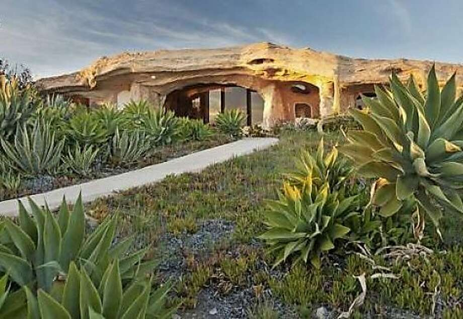Both the interior and the exterior of the home have been designed to resemble rock formations. Photo: Courtesy Of TheMLS.com