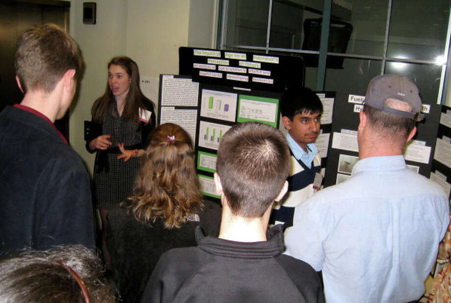 Students at last year's event talk to the attendees. Photo: Contributed Photo