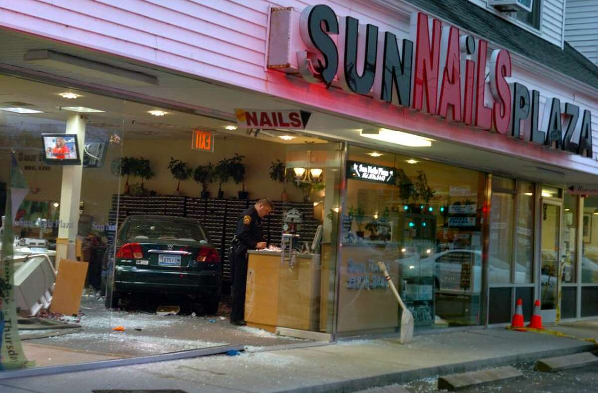 A car crashed into the Sun Nails salon in Milford, Conn. Thursday Nov. 12, 2009 injuring several people.