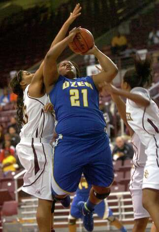Ozen's Nekia Jones goes up for a basket against Summer Creek at the M.O. Campbell Center in Aldine, Friday, February 17, 2012. Tammy McKinley/The Enterprise Photo: TAMMY MCKINLEY