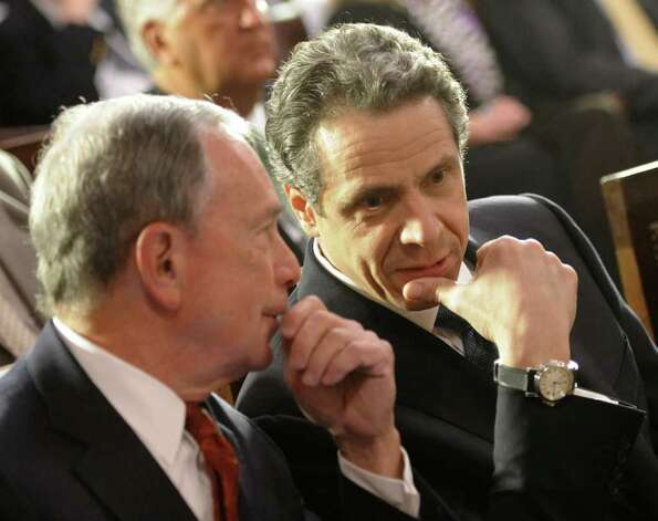 Gov. Andrew Cuomo and New York City Mayor Michael Bloomberg before Cuomo signed the pension reform bill into law in the Red Room of the State Capitol in Albany, N.Y. March 16, 2012.   (Skip Dickstein/Times Union) Photo: Skip Dickstein / 2011