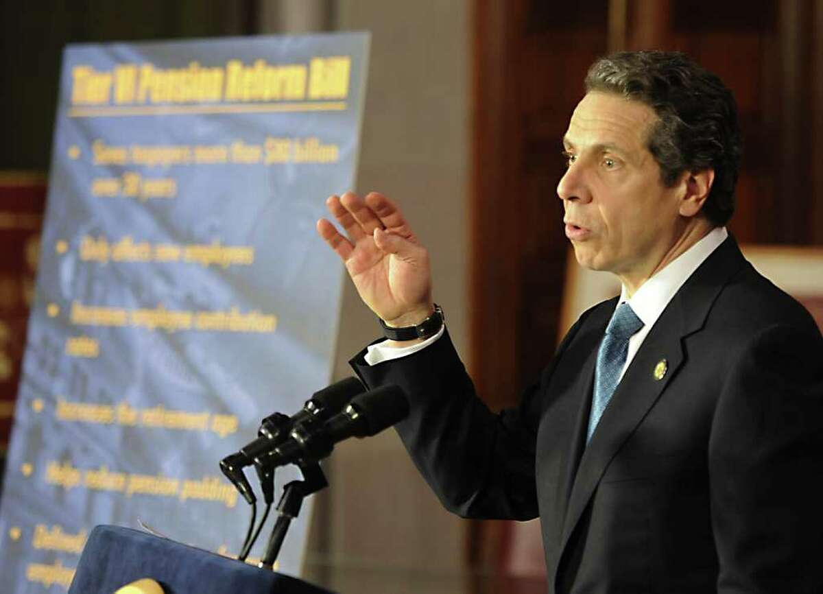 Gov. Andrew Cuomo speaks to the gathering of state and local officials before he signed the pension reform bill into law in the Red Room of the State Capitol in Albany, N.Y. March 16, 2012. (Skip Dickstein/Times Union)