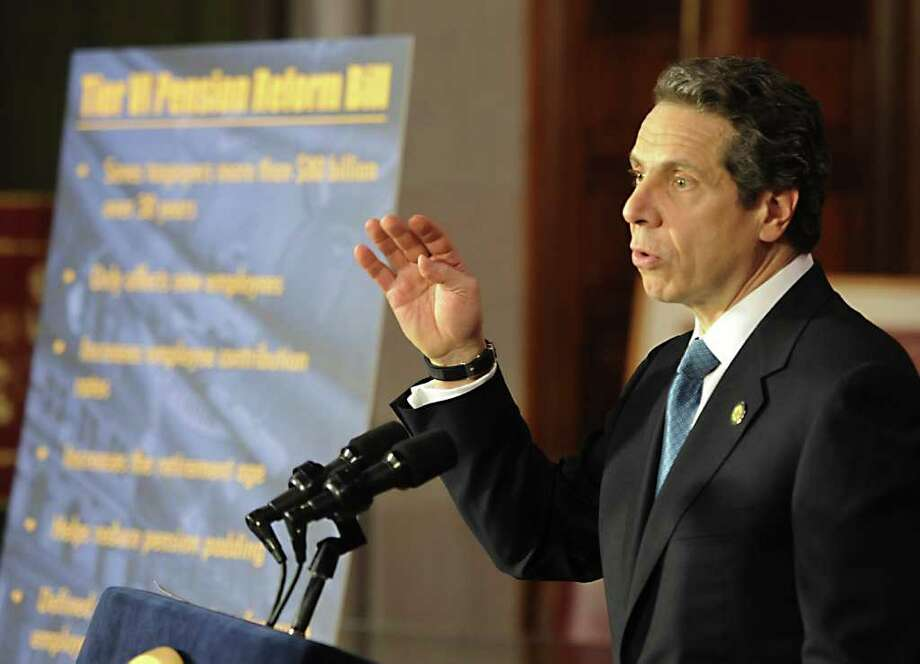 Gov. Andrew Cuomo speaks to the gathering of state and local officials before he signed the pension reform bill into law in the Red Room of the State Capitol in Albany, N.Y. March 16, 2012.   (Skip Dickstein/Times Union) Photo: Skip Dickstein / 2011