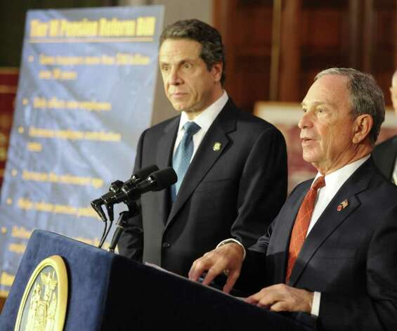 Gov. Andrew Cuomo listens as New York City Mayor Michael Bloomberg speaks before the signing of the pension reform bill in tolaw in the Red Room of the State Capitol in Albany, N.Y. March 16, 2012.   (Skip Dickstein/Times Union) Photo: Skip Dickstein / 2011