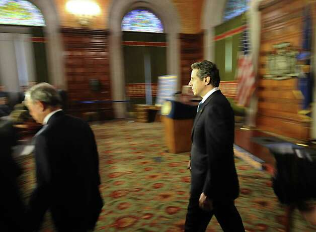 Gov. Andrew Cuomo enters the room with New York City Mayor Michael Bloomberg before the signing of the pension reform bill into law in the Red Room of the State Capitol in Albany, N.Y. March 16, 2012.   (Skip Dickstein/Times Union) Photo: Skip Dickstein / 2011