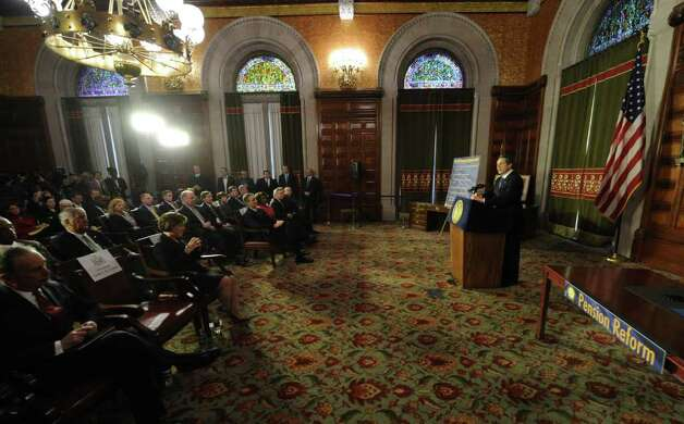 Gov. Andrew Cuomo speaks before signing the pension reform bill into law in the Red Room of the State Capitol in Albany, N.Y. March 16, 2012.   (Skip Dickstein/Times Union) Photo: Skip Dickstein / 2011