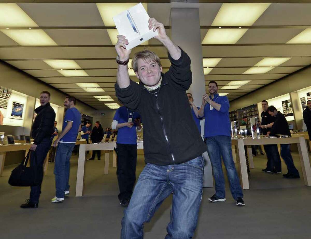 Lukas from Germany is the first to get the new iPad at the Apple store in a shopping mall in Oberhausen, western Germany, Friday, March 16, 2012. Apart from a few countries, there is an internationally coordinated simultaneous release of the iPad.