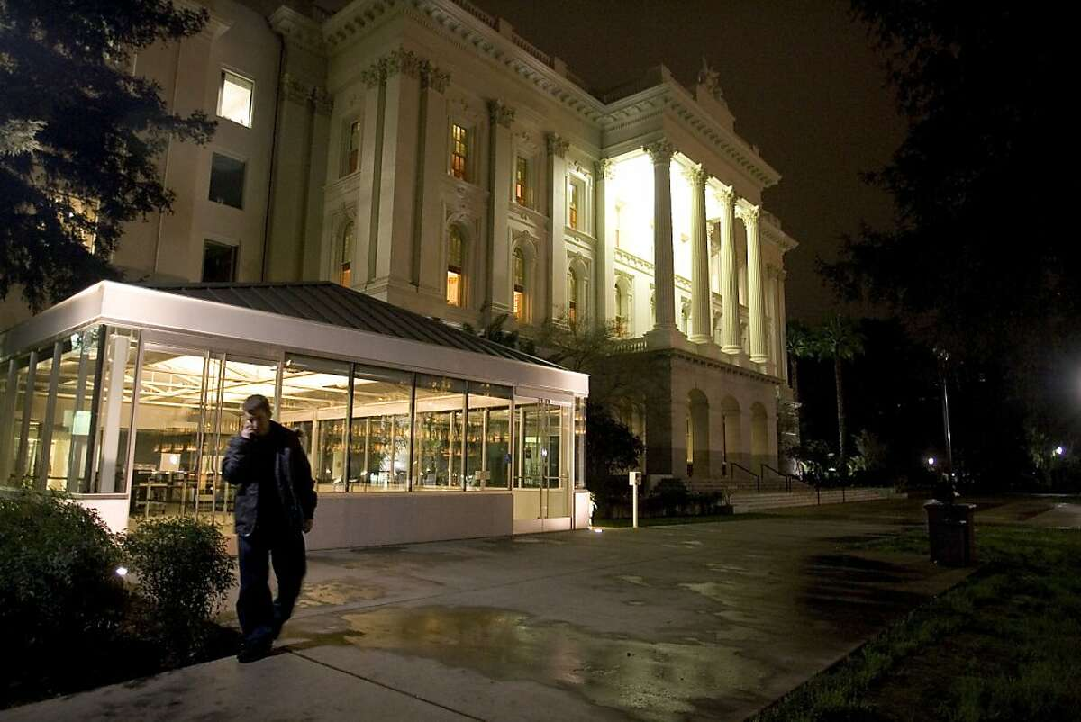 A man leaves the state Capitol after the building was closed for the evening, February 10, 2009, in Sacramento, Californina. Legislative leaders and Governor Arnold Schwarzenegger were still meeting after 9 pm in attempt to solve the state's budget crisis.