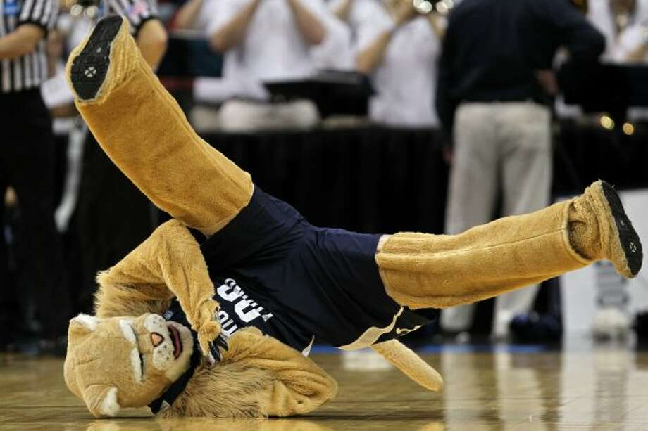 Pretty sure BYU's Honor Code has a rule against what mascot Cosmo the Cougar is doing here. (Jonathan Daniel / Getty Images)