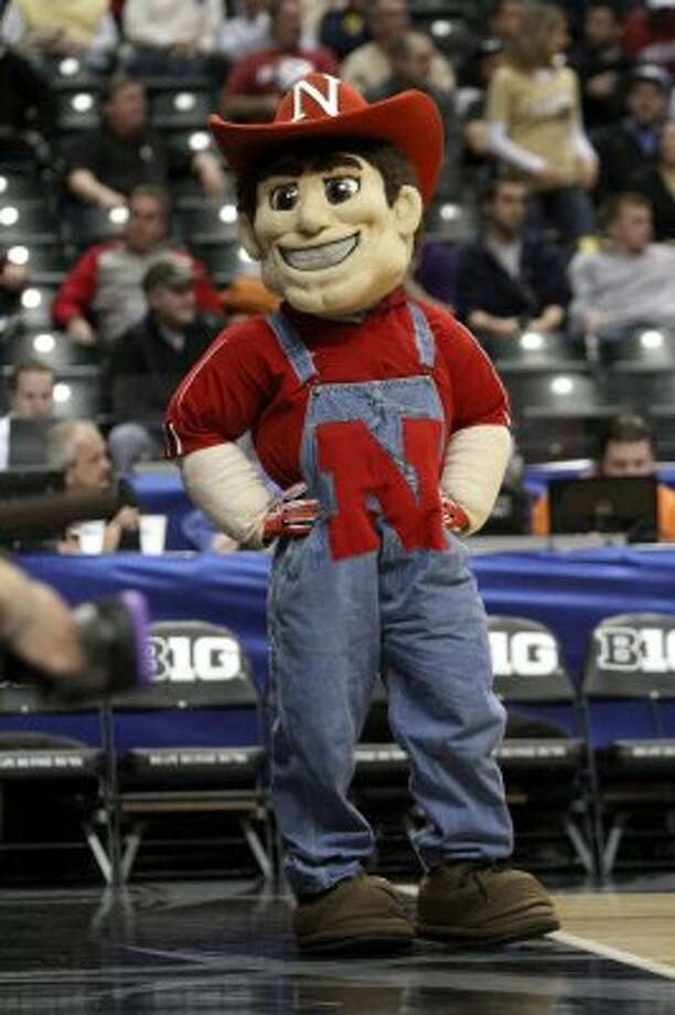 That big grin on Nebraska's Herbie Husker must be very ironic when the team loses. (Kiichiro Sato / Associated Press)