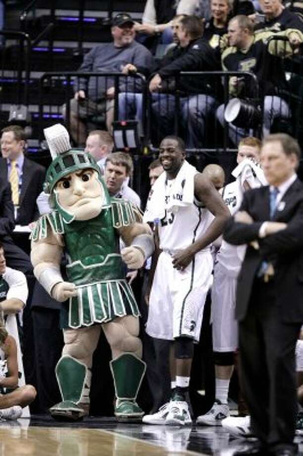 Sparty the Michigan State Spartan must have a heck of a workout program. The muscles on his legs have muscles. (Michael Conroy / Associated Press)