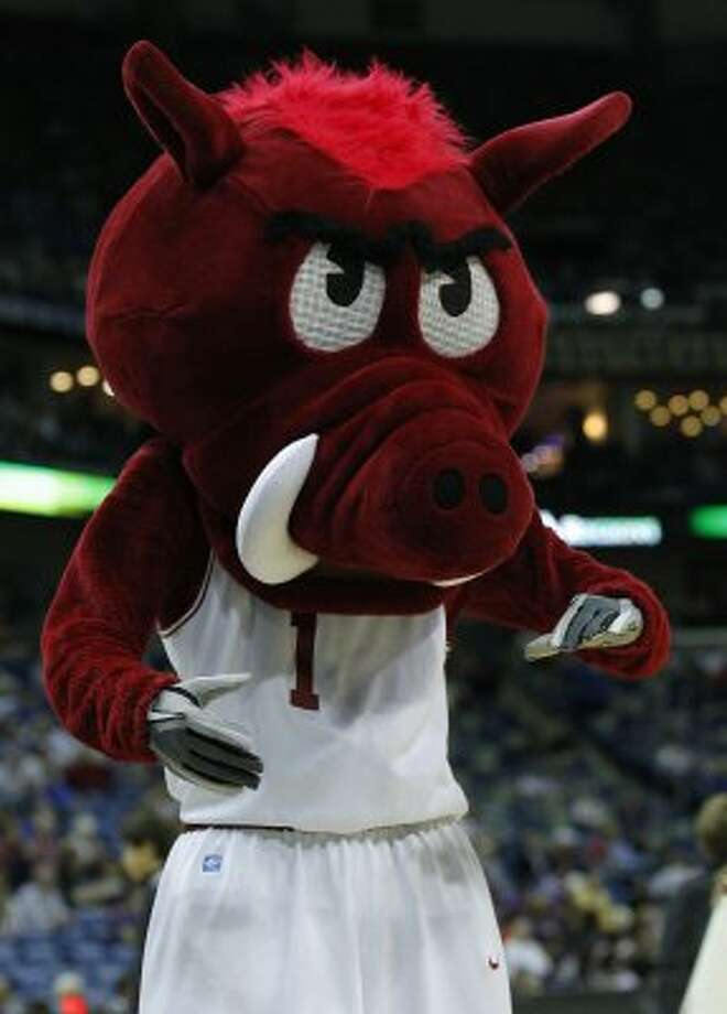 Ribby the Razorback of Arkansas is also ready for football season with his gloved hands. (Bill Haber / Associated Press)