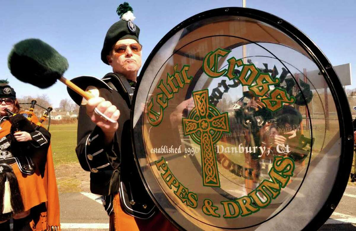 Tom Wall beats a drum with the Celtic Cross Pipes & Drums of Danbury that marched in the St. Patrick's Day parade in Danbury, Sunday, March 20, 2011.