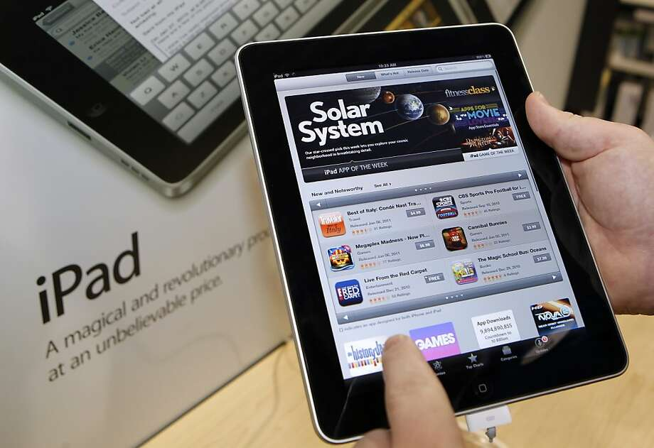 With 225,000 apps specifically tailored for the iPad available in the App Store, Apple has a big edge over competing tablets. Photo: George Frey, Bloomberg