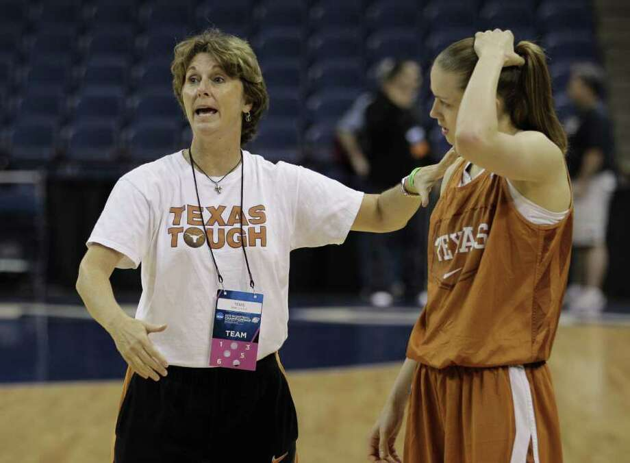Texas head coach Gail Goestenkors directs Texas guard Chassidy Fussell (24) during practice for  their first round NCAA basketball game in Norfolk, Va., Friday, March 16, 2012. Texas plays West Virginia in an NCAA tournament first-round women's college basketball game on Saturday. Photo: AP