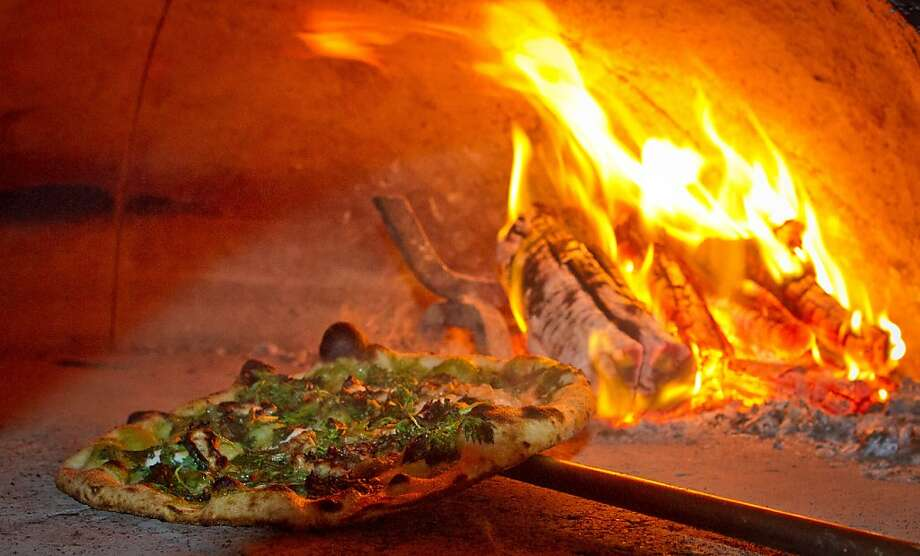 At Oenotri in downtown Napa, diners can indulge in a taste of Southern Italy. The menu changes nightly, but you can't go wrong with one of the wood-fired pizzas. Read the review. Photo: John Storey, Special To The Chronicle