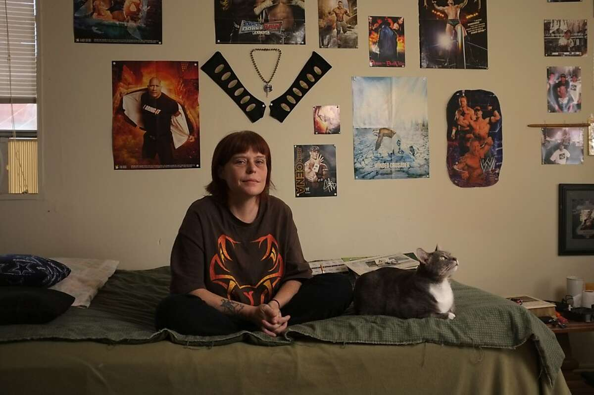 Melissa Huffine Woods is shown in her apartment with her cat Mysterio in Oak Ridge, Tenn. on Friday, March 9, 2012. Woods' aunt Roberta Armtrout was murdered in 1985 and found near the town of Linden. Although it remains an unsolved murder, some people are convinced she was killed by the Speed Freak Killers, Loren Herzog and Wesley Shermantine.