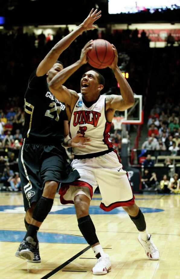 Colorado forward Andre Roberson (left) plays defense on UNLV guard Anthony Marshall during an NCAA tournament second-round game  Thursday. Colorado won 68-64. Photo: AP