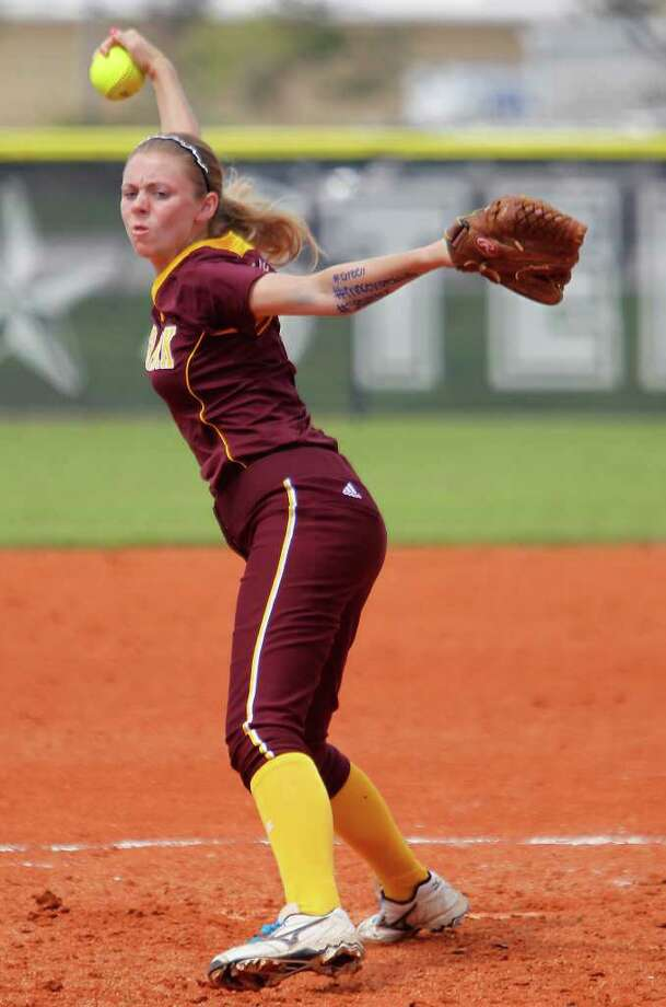 Deer Park's starting pitcher Kaitlyn Plocheck (1)  pitches in the first inning during a high school girls softball game at Baytown Sterling High School, Friday, March 16, 2012, in Baytown. Deer Park won the game 7-0. Photo: Karen Warren, Houston Chronicle / © 2012  Houston Chronicle