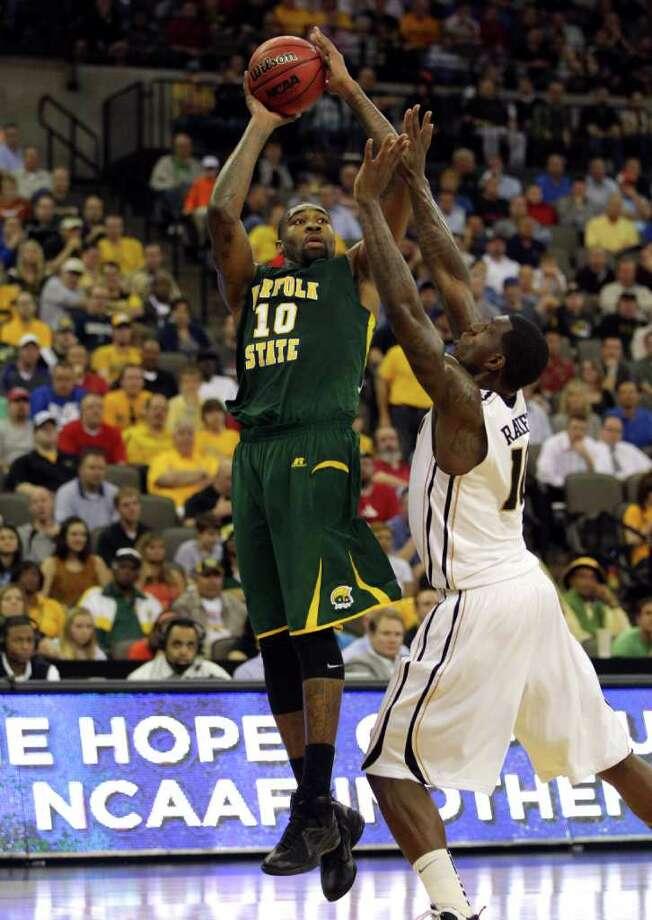 Norfolk State's Kyle O'Quinn rises up for a shot against Ricardo Ratliffe of Missouri. Photo: Doug Pensinger, Getty Images / 2012 Getty Images