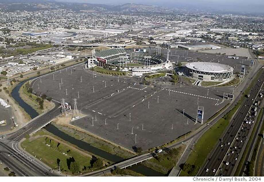 Oakland Coliseum and Arena with parking lot and stadium (known as Network Associates). 8/12/04 in Oakland  Darryl Bush / The Chronicle Photo: Darryl Bush