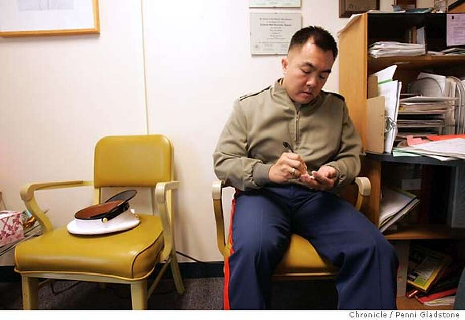 "RECRUIT_057_PG.JPG Gunnery Sergeant Jacinto Bernardo sit in a counselors office at Oceana High for a quick visit. He spoke to counselor about why his military brochures are always being taken. Story is about military recruiting in the bay area. It's a news feature and involves both recruiters and the peace activists who are ""counter recruiters."" . The San Francisco Chronicle, Penni Gladstone  Photo taken on 6/6/05, in Pacifica, Photo: Penni Gladstone"