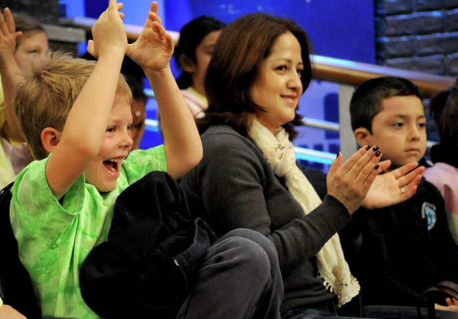 Rogers International School student Ryan Hoffman cheers for Jack Hannah during a filming of the Maury Show in Stamford on Friday, March 16, 2012. Photo: Lindsay Niegelberg / Stamford Advocate