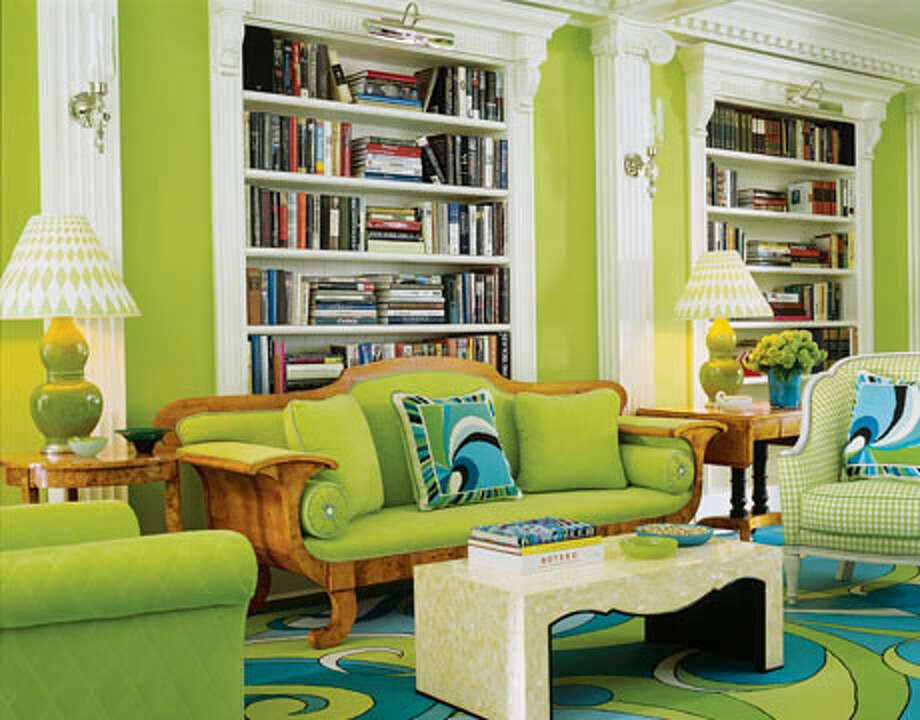 """Shocking Green Living Room This Manhattan living room has major """"wow"""" factor. Designers Anthony Baratta and William Diamond weren't afraid to use color - they even dyed the upholstery to match the chartreuse walls.  Reprinted with Permission of Hearst Communications, Inc. Originally Published: 10 Gorgeous Green Rooms Tria Giovan"""