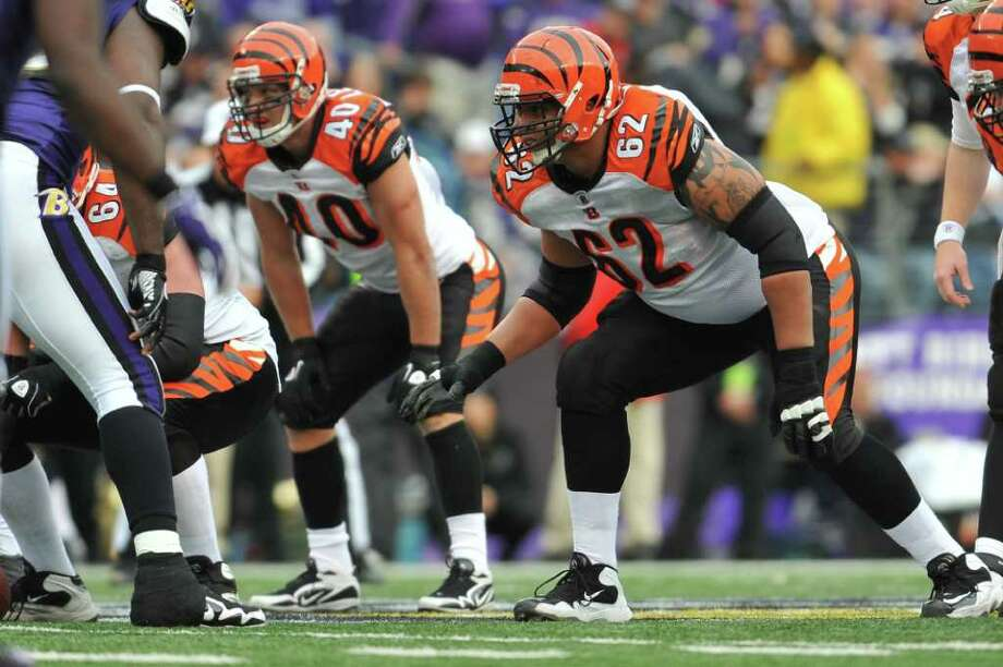 Nate Livings (62) of the Bengals blocks against the Ravens last season. Livings signed a reported five-year deal with the Cowboys. Photo: Larry French, Getty Images / 2011 Larry French