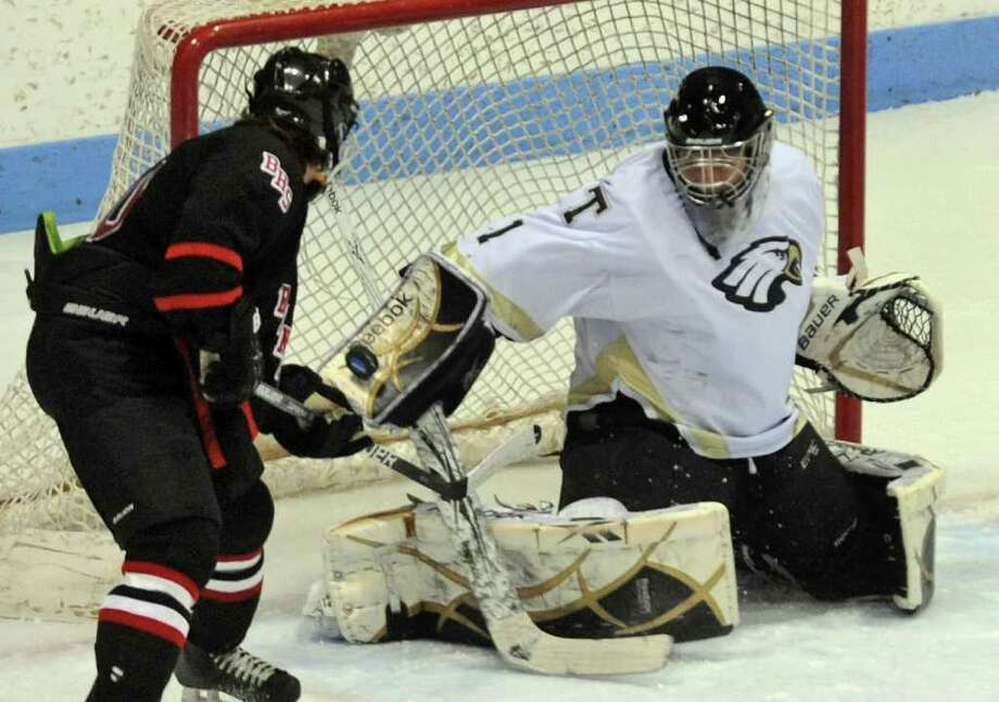 Trumbull goalie Matthew Paolini deflects a shot by Branford's #10 Rob Celantano, during Division II boys ice hockey state final action in New Haven, Conn. on Friday March 16, 2012. Photo: Christian Abraham / Connecticut Post