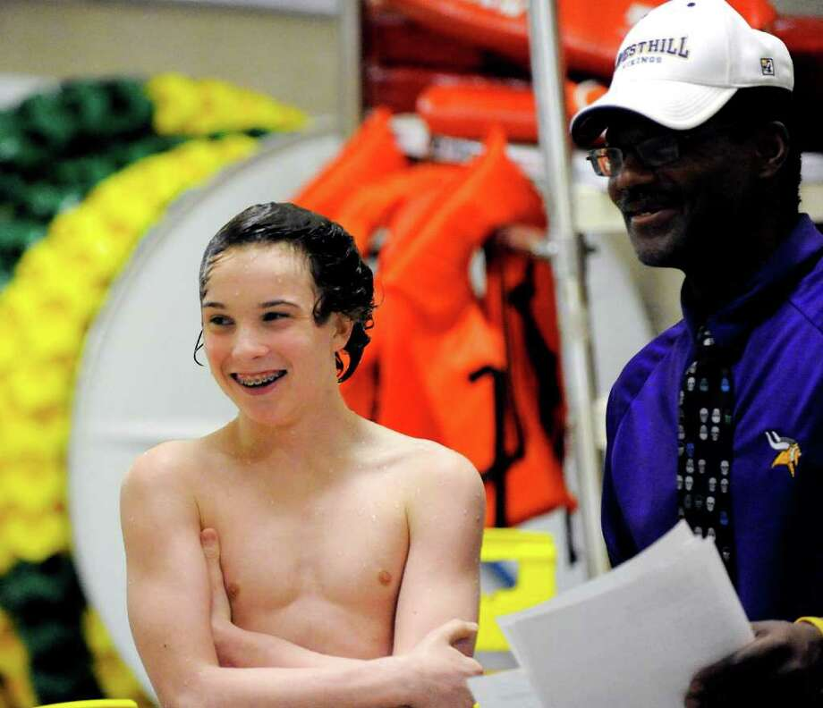 Westhill High's Sean Burston won the State Open diving championship on Thursday night in Hamden. At right is Burston's coach, Jim Bowser. Photo: Bob Luckey / Greenwich Time