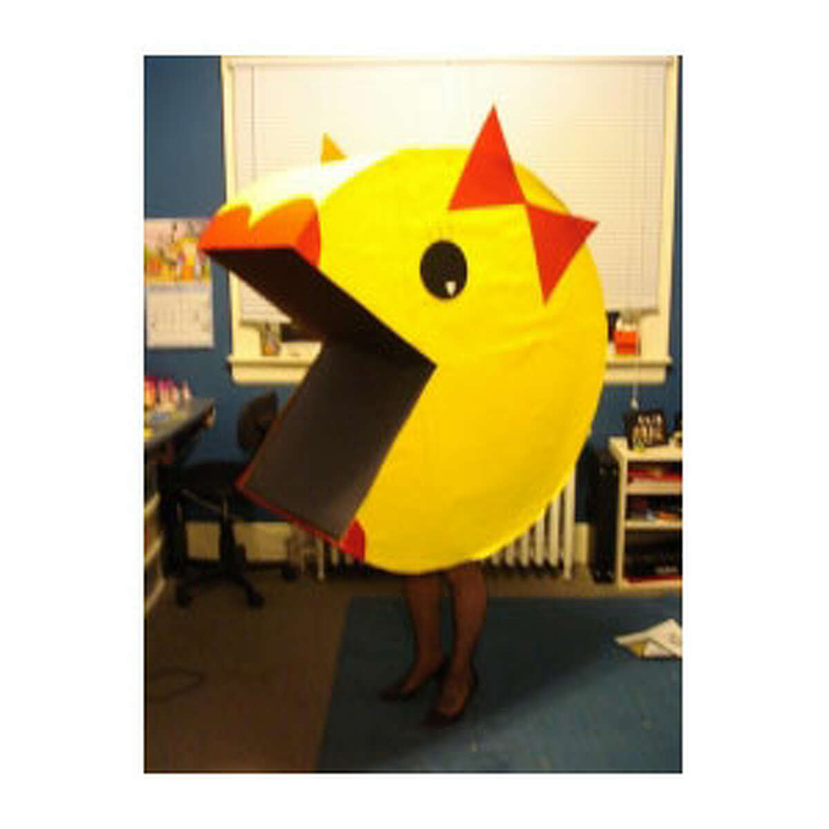 Ms. Pac-Man is made out of cardboard, posterboard, felt and a belt. I ended up making her so big that she didn't fit in my car so I had to borrow someones station wagon!