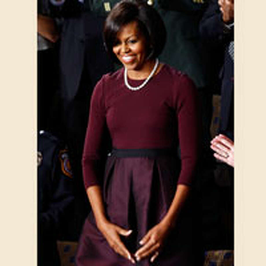 Michelle Obama looks classically elegant at President Obama's first State of the Union address in a three-quarter-sleeve dress with a bubble skirt by Isaac Mizrahi paired with a classic strand of pearls.  Reprinted with Permission of Hearst Communications, Inc. Originally Published: Michelle Obama's Style Chip Somodevilla/Getty Images