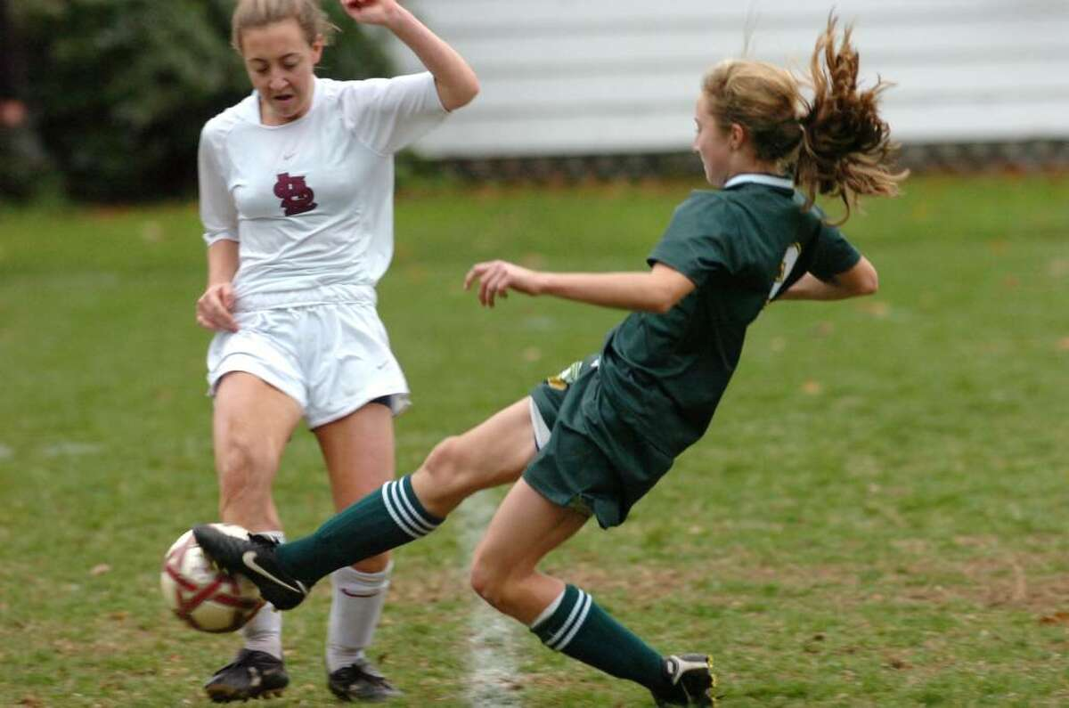 St. Luke's April Walsh collides with GA's Hannah Withiam as Greenwich Acedemy hosts St. Luke's in the FAA girls soccer finals. GA won 2-1.