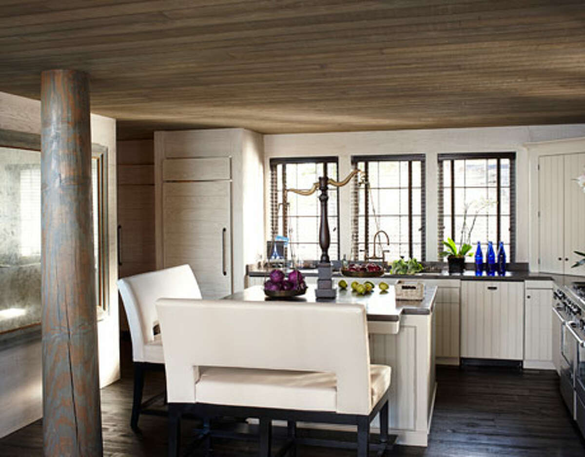 Furniture choices should be guided by practicality. Creamy faux-leather benches and the gleam of buffed concrete countertops make the kitchen feel as hospitable as the dining room. This is the perfect solution for small spaces if you want both an island and a kitchen table. Reprinted with Permission of Hearst Communications, Inc. Originally Published: 15 Simple Solutions for an Organized Kitchen