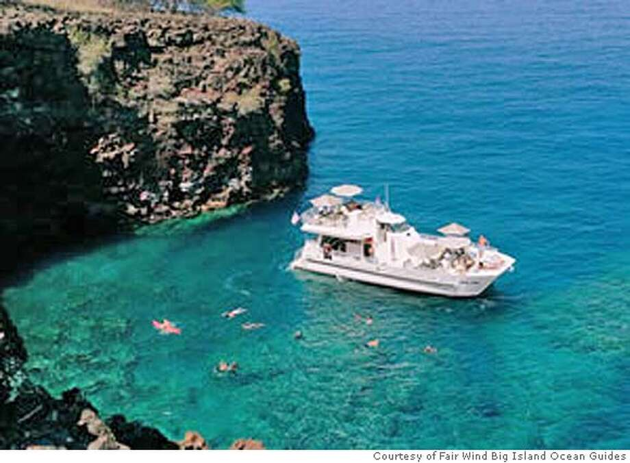 The Hula Kai offers adults-only snorkel tours of the Big Island's stunning Kona coastline. Photo courtesy of Fair Wind Big Island Ocean Guides