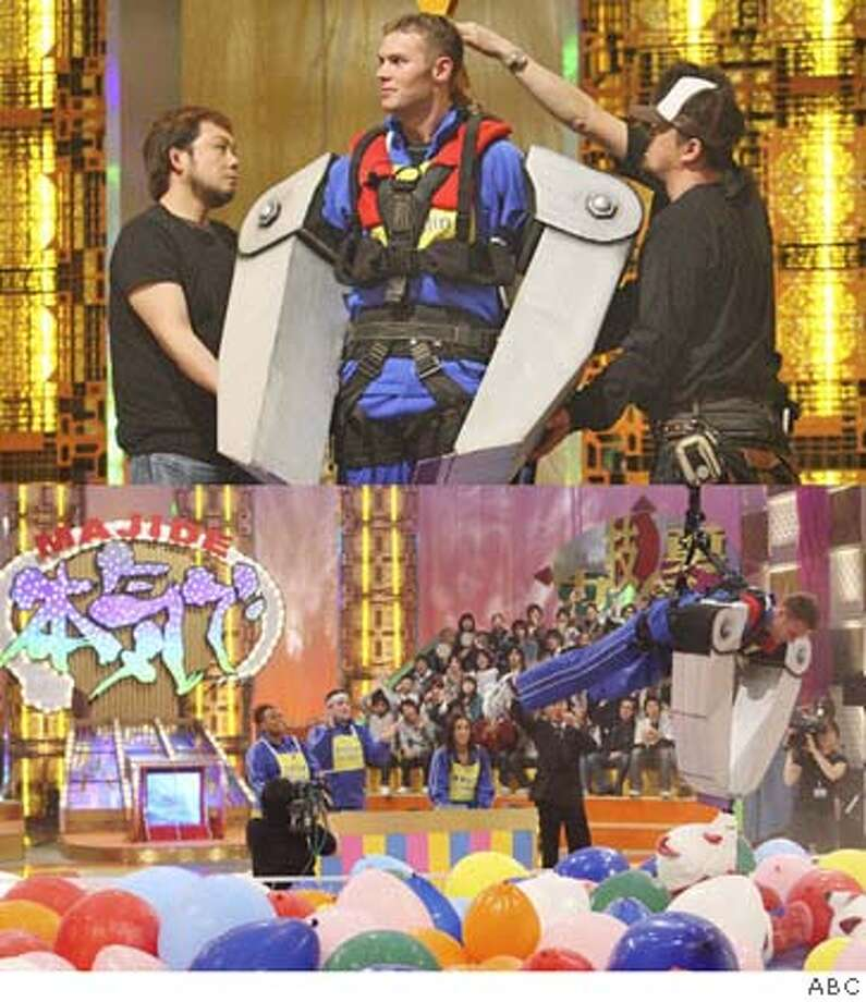 "The Long Arm of the Claw: A contestant goes for the bear necessities  in ""I Survived a Japanese Gameshow."" Photo by ABC"