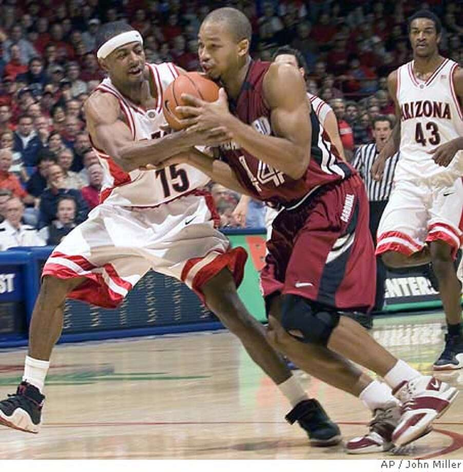Arizona's Mustafa Shakur (15) and Stanford's Fred Washington (44) struggle for control of the ball during the second half of college basketball at McKale Center in Tucson, Ariz., Saturday, Dec. 30, 2006. Arizona won 89-75. (AP Photo/John Miller) Photo: John Miller