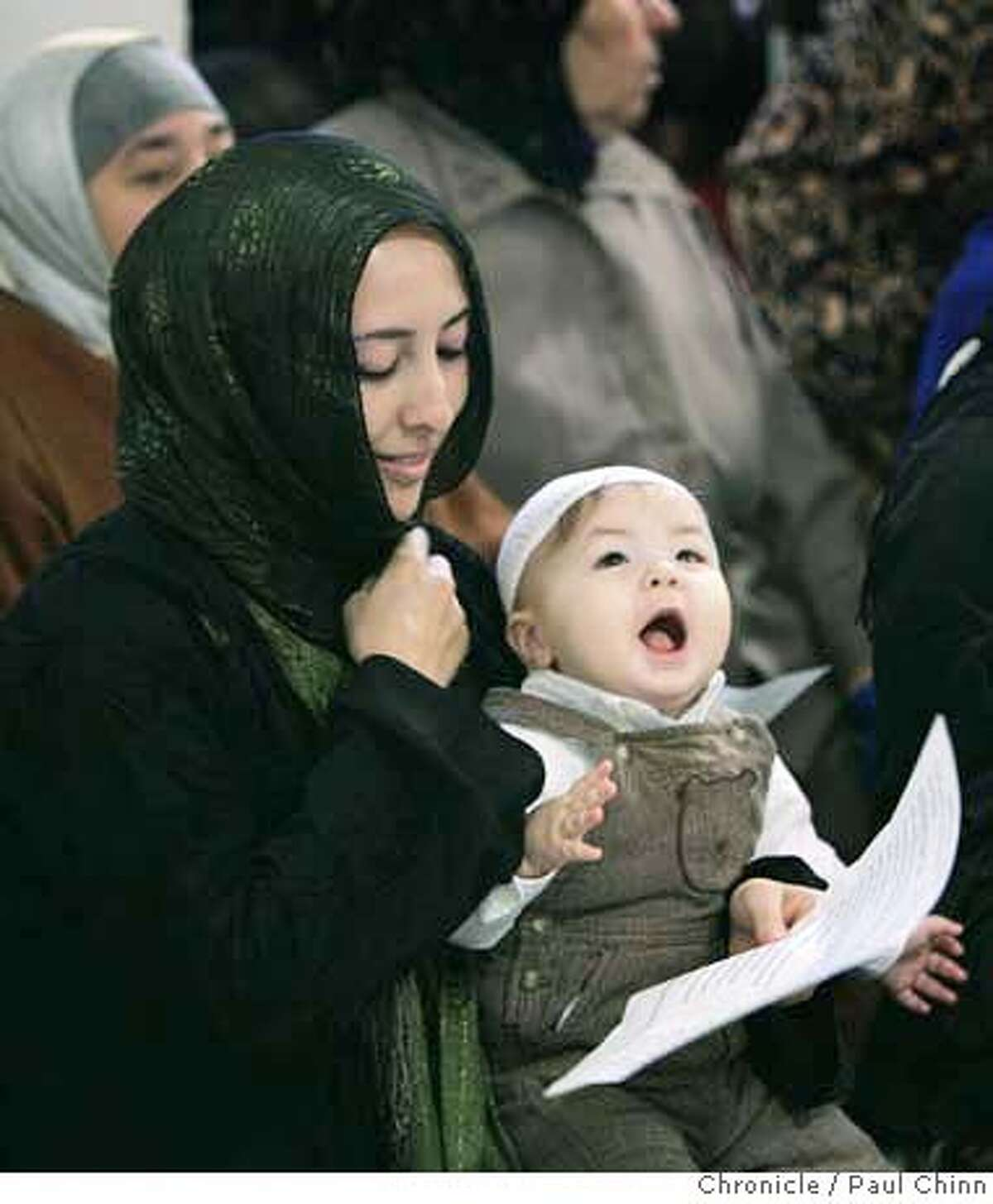 Sarah Alalusi and her son Deen joined other Muslims to celebrate the Eid Al Adha (cq) holiday at Masjid Al Iman in Oakland, Calif. on Saturday, Dec. 30, 2006. According to a statement released by the mosque, the Eid Al Adha, or Festival of Sacrifice, coincides with the annual pilgrimage to Makkah, Saudi Arabia. PAUL CHINN/The Chronicle **Sarah Alalusi, Deen
