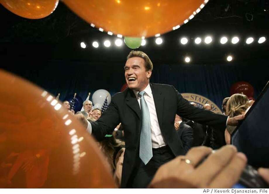 ** ADVANCE FOR WEEKEND DEC. 30-31 FILE ** In this Nov. 7, 2006, file photo, Gov. Arnold Schwarzenegger shakes hands with supporters as he celebrates at the victory party in Beverly Hills, Calif. It was mostly a year of triumph for the erstwhile Terminator who signed legislation to fight global warming and flattened Democratic candidate Phil Angelides in the November election. (AP Photo/Kevork Djansezian) **ADVANCE FOR WEEKEND OF DEC. 30-31** **FILE** Photo: Kevork Djansezian