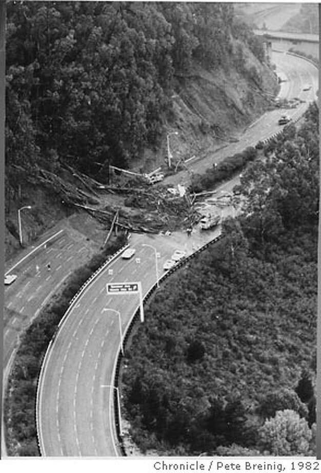 A 1982 storm caused a landslide in Marin County that blocked Highway 101 and forced the closure of the Golden Gate Bridge.  Ran on: 12-31-2006  A January 1982 storm caused a landslide that forced the closure of the Golden Gate Bridge and Highway 101. Photo: Pete Breinig/The Chronicle 1982
