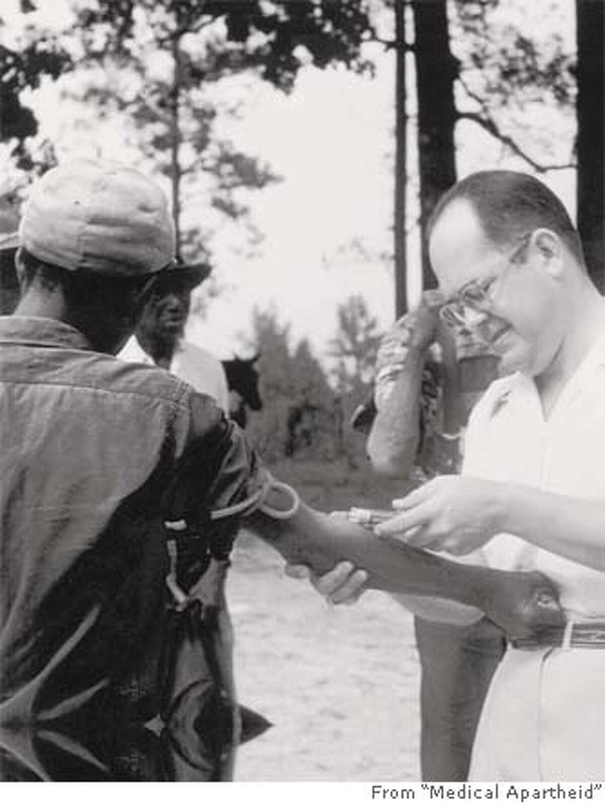 A U.S. Public Health Service doctor in Tuskegee, Ala., injects an African American man, giving him the false impression that his disease was being treated, in the 1932 Tuskegee Syphilis Study. Photo courtesy of Doubleday