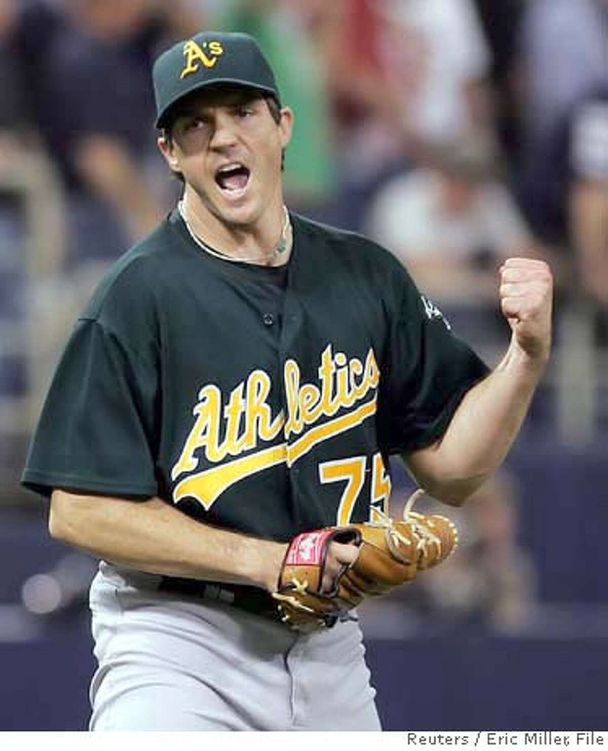 Oakland Athletics starting pitcher Barry Zito reacts to retiring Minnesota Twins batter Joe Mauer to end the eighth inning of Game 1 of the American League Divisional Series in Minneapolis, Minnesota in this October 3, 2006 file photo. Former Cy Young award winning pitcher Zito has signed a seven-year $126 million contract with the San Francisco Giants, the biggest ever for a Major League Baseball pitcher, local media reported on December 28, 2006. REUTERS/Eric Miller/Files (UNITED STATES) 0