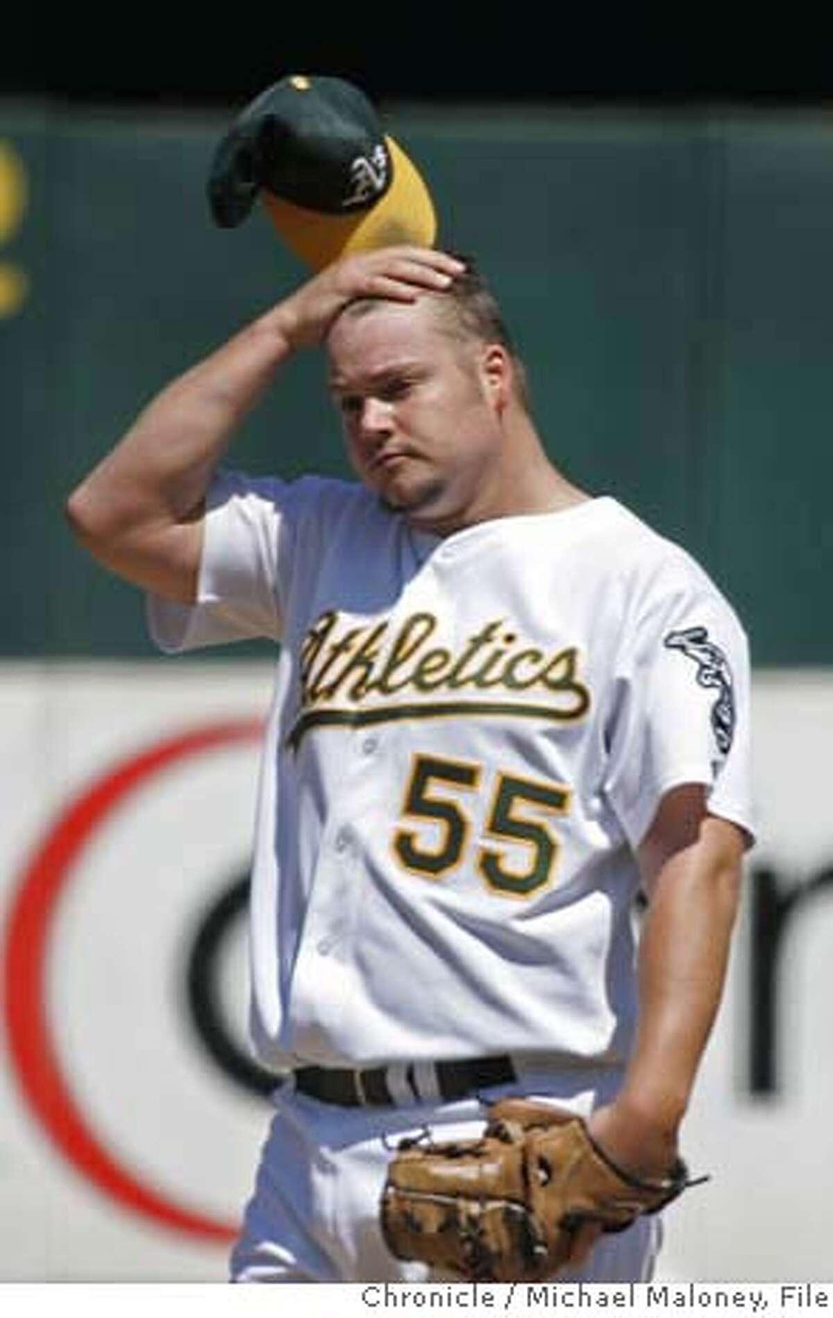 Starting pitcher Joe Blanton was frustrated in a tough 3rd inning. Oakland Athletics vs Texas Rangers at McAfee Coliseum. A's won 9-6. Photo by Michael Maloney / San Francisco Chronicle on 9/6/06 in Oakland,CA MANDATORY CREDIT FOR PHOTOG AND SF CHRONICLE/ -MAGS OUT